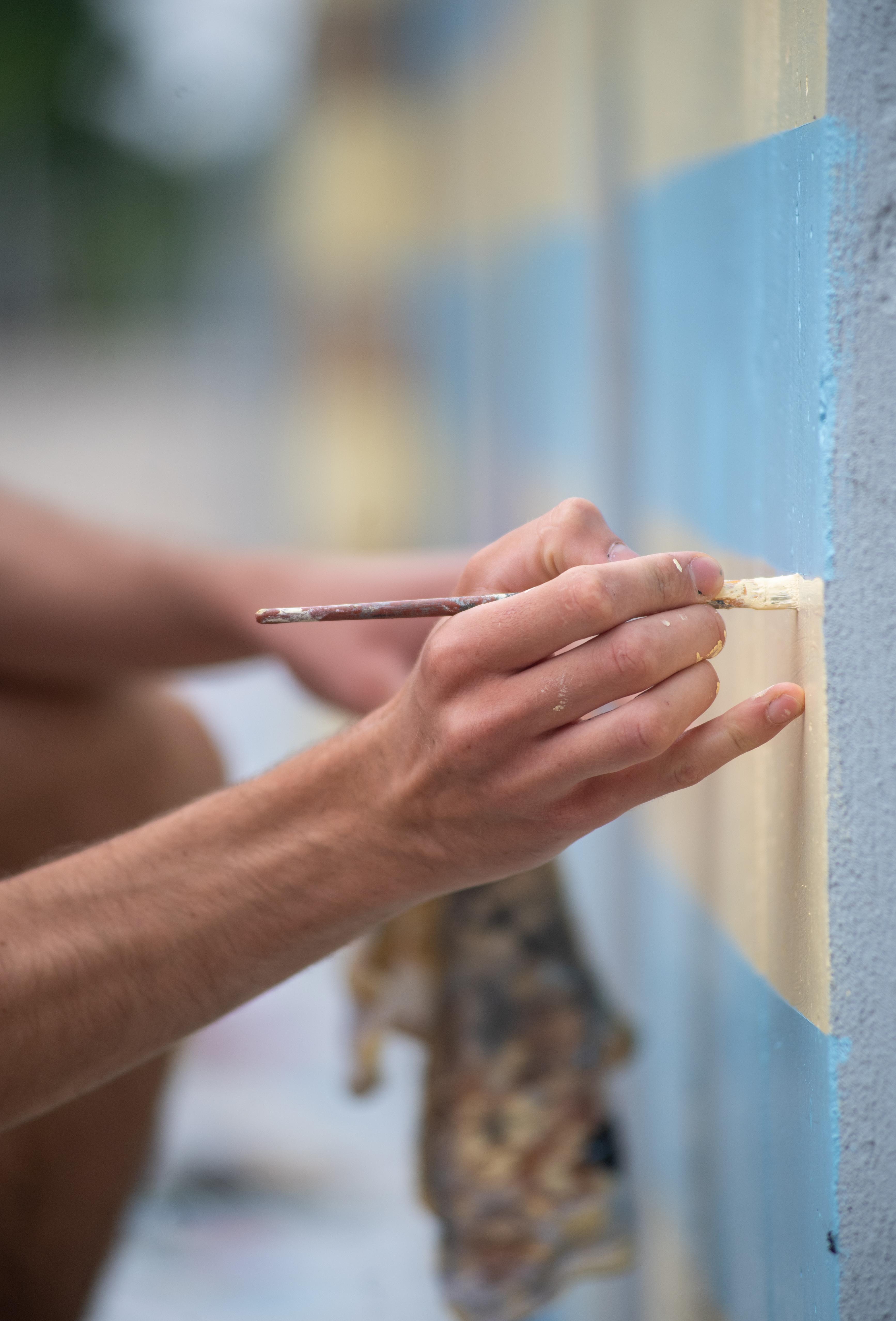artist painting health care heroes mural