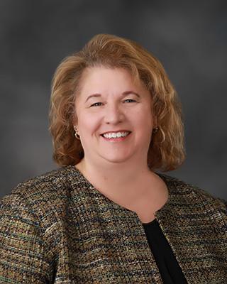 Kim Bassett President of SJMC