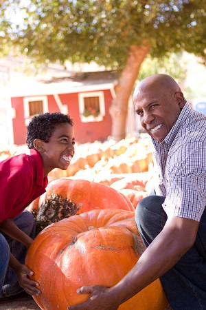 son and father with pumpkin