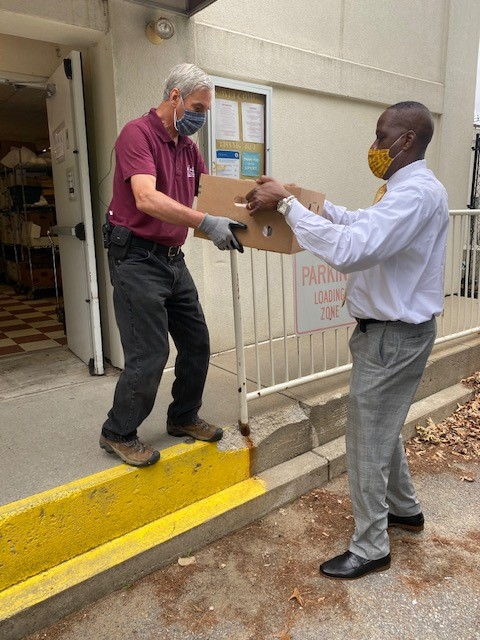 Houston Stevens delivers food donations to the Loaves and Fishes food pantry.