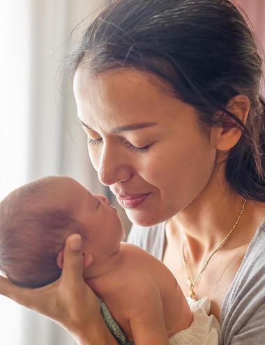 mom holding baby
