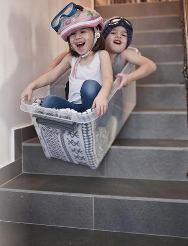 kids sliding down stairs