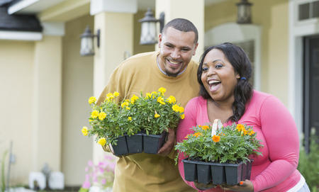 Happy couple with flowers