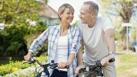 Smiling couple on bikes