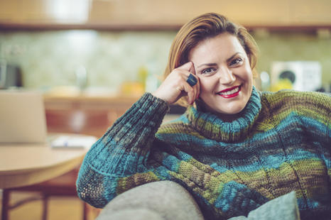 smiling woman in green sweater