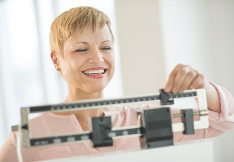 Happy woman on scales