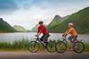 Middle age couple biking