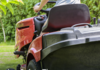 Man riding on lawn mower